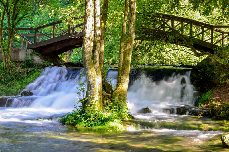 Waterfall of river Bosna near Sarajevo. Spring of the Bosna river, small waterfall and park Vrelo Bosne near Sarajevo - Bosnia and Herzegovina stock images