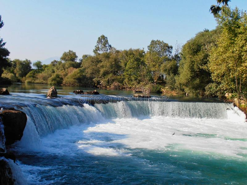a waterfall in the river stock photos