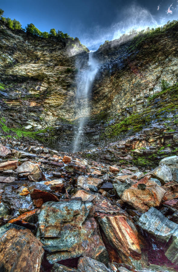 Waterfall on rocky cliff stock images