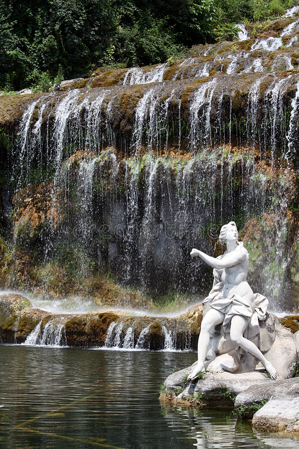 Waterfall and sculpture royalty free stock image