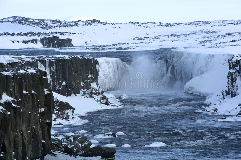 Waterfall Selfoss in Iceland, wintertime. Wide shot of waterfall Selfoss in Iceland, wintertime royalty free stock photography