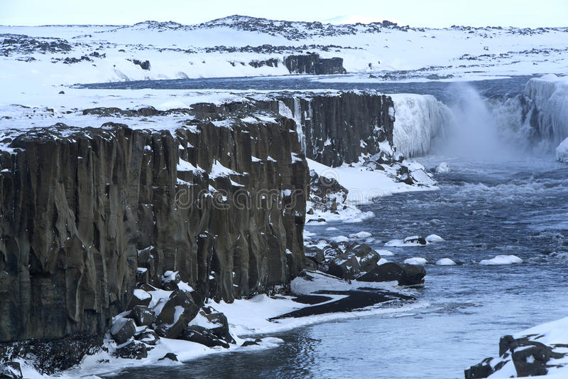 Waterfall Selfoss in Iceland, wintertime. Wide shot of waterfall Selfoss in Iceland, wintertime stock photo