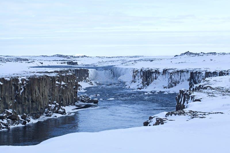 Waterfall Selfoss in Iceland, wintertime. Wide shot of waterfall Selfoss in Iceland, wintertime stock photography