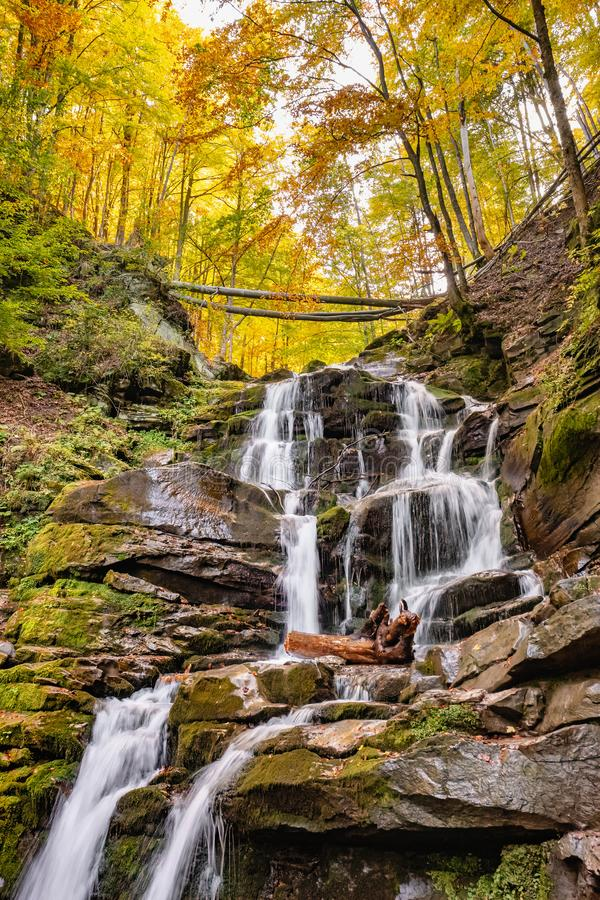 Waterfall Shypit in the autumn forest in Carpathian mountains, Ukraine stock photos