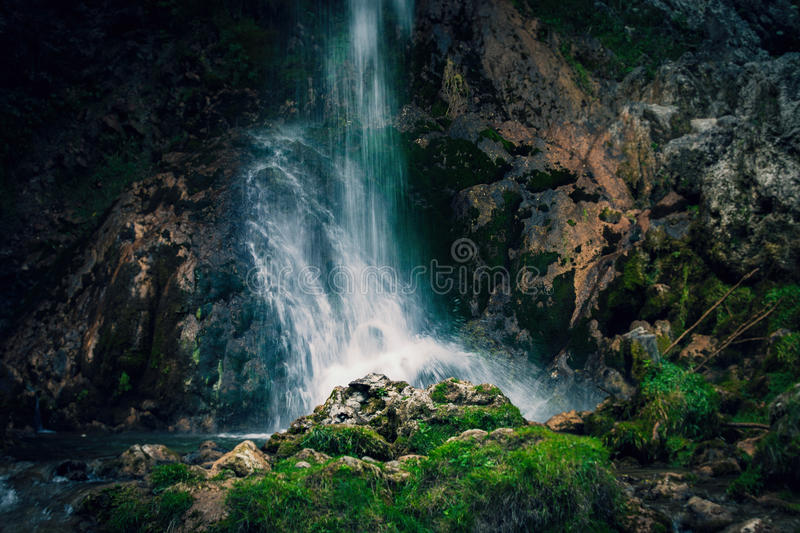Waterfall on small mountain river stock photography