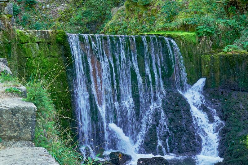 Waterfall at Source du Doubs Mouthe Franche Comté France with Green Plants. On A Sunny Day stock photos
