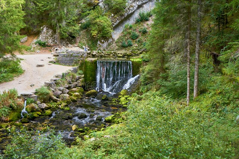 Waterfall at Source du Doubs Mouthe Franche Comté France with Green Plants. On A Sunny Day stock images