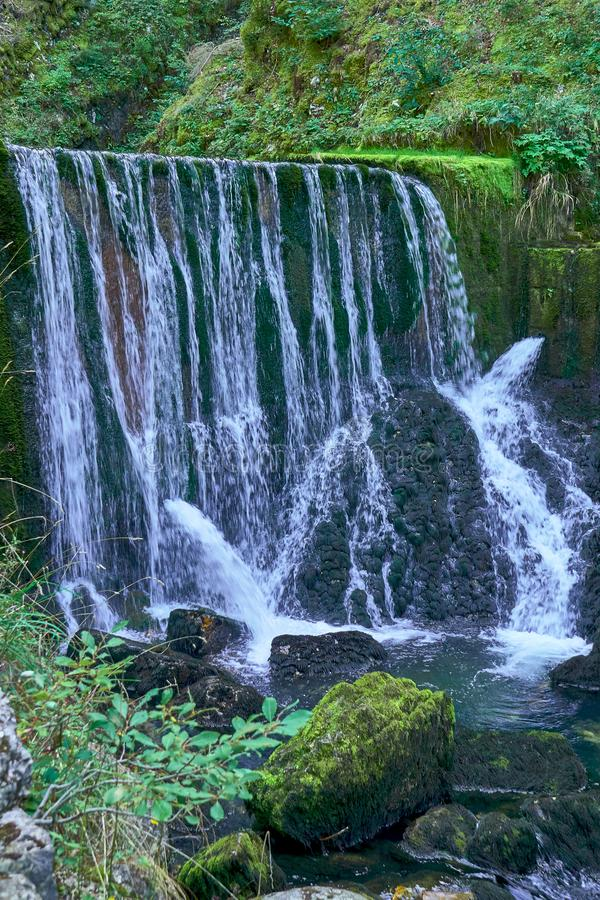 Waterfall at Source du Doubs Mouthe Franche Comté France with Green Plants. On A Sunny Day royalty free stock image