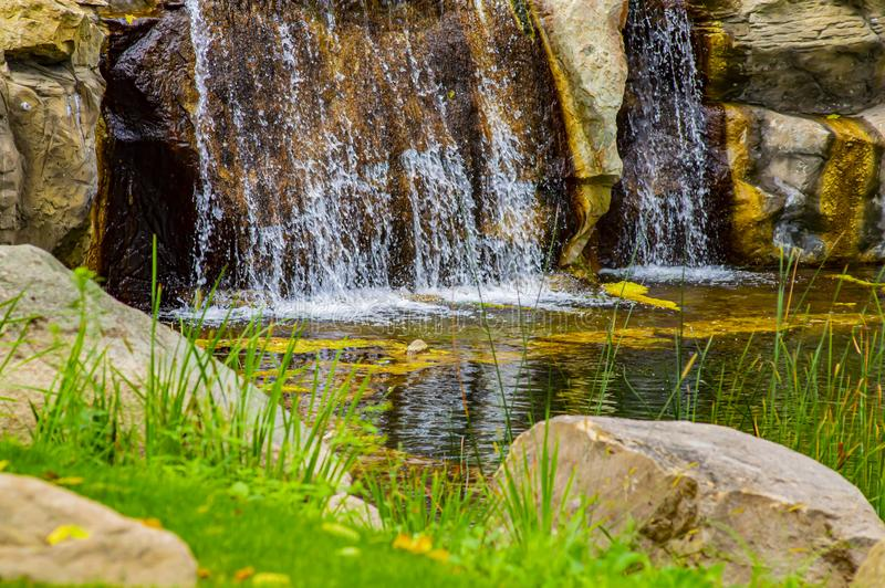 Waterfall stream mountain river over stones stock image
