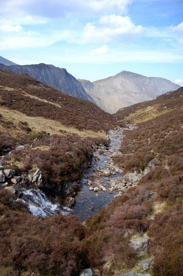 Waterfall and stream near Haystacks. Waterfall and stream on the path leading to Haystacks, a mountain in the Lake District, England stock images