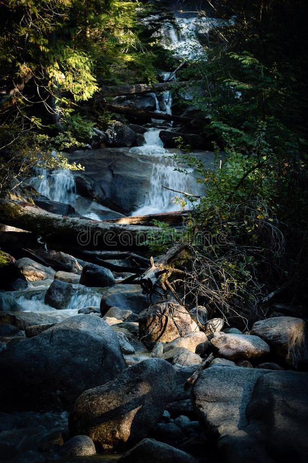 Waterfall and stream with rocks royalty free stock image