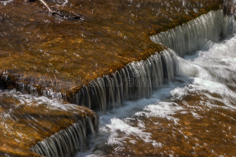 Waterfall in a stream stock photos