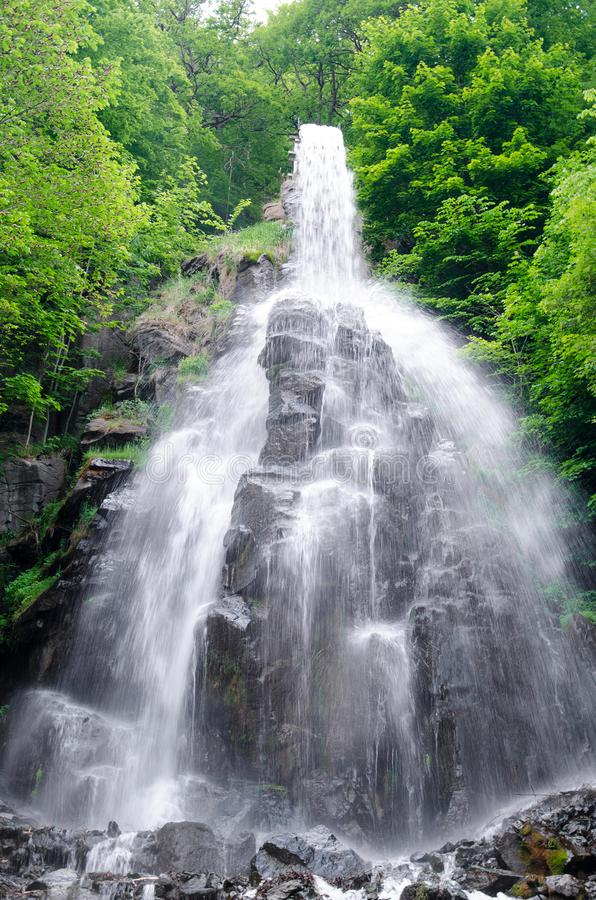 Waterfall on a sunny day royalty free stock image