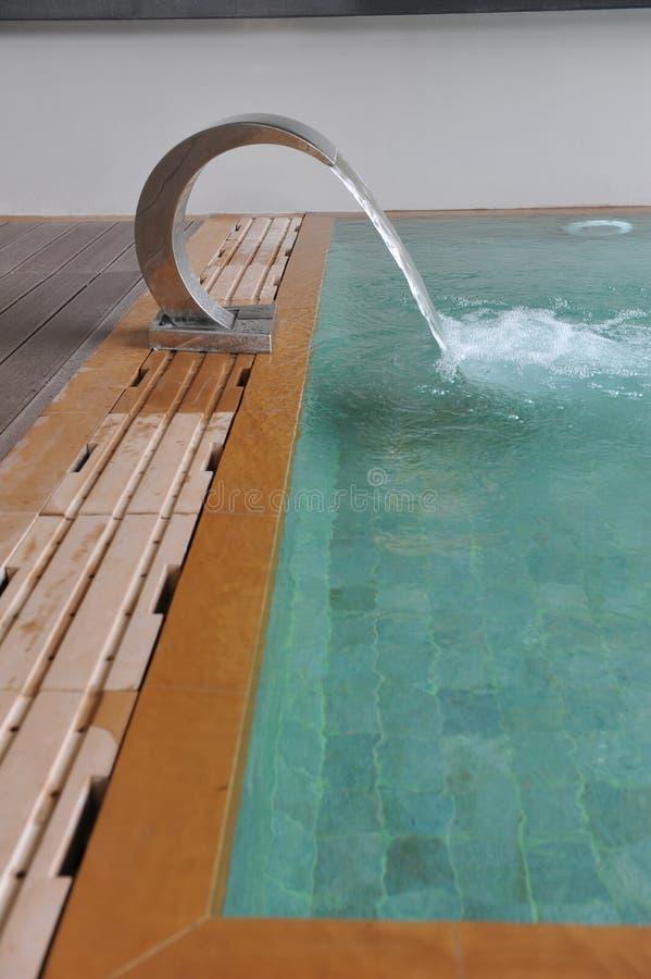 Waterfall in swimming pool stock photo