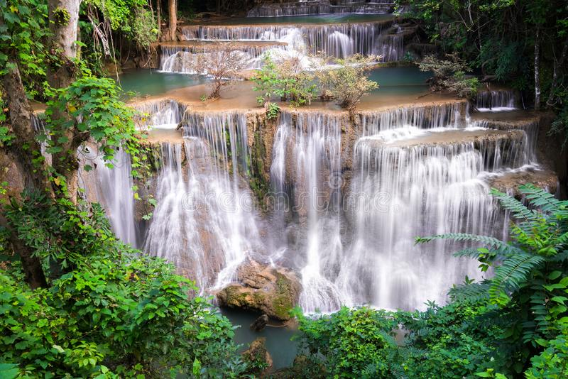 Waterfall in Thailand, called Huay or Huai mae khamin in Kanchanaburi Provience. Around with forest environment and emerald water stock photography