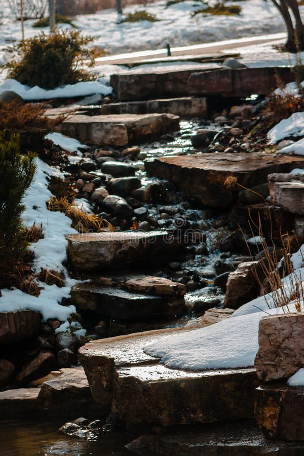 Waterfall trickling down some stones on a winter day. At the Frederik Meijer Gardens royalty free stock images