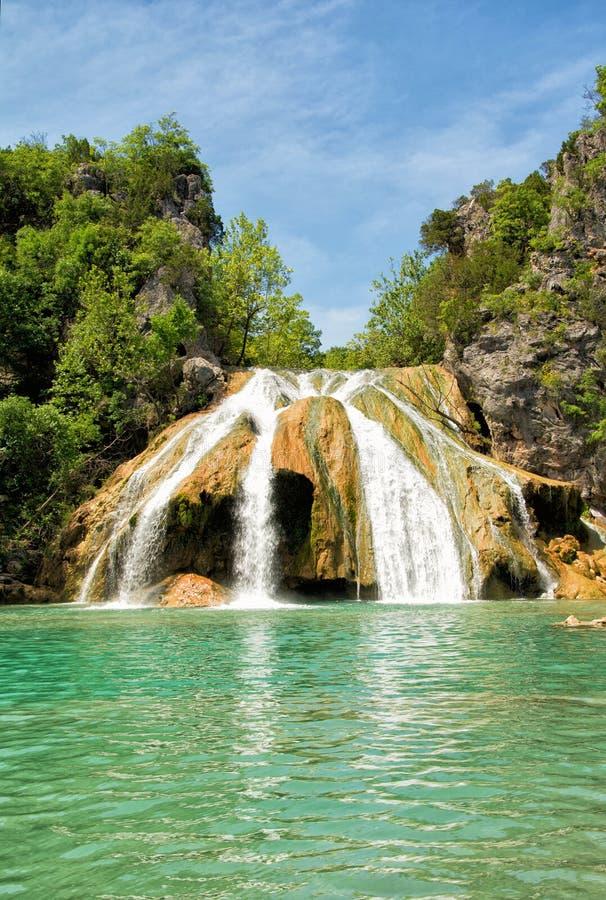 Waterfall at Turner Falls, Oklahoma, with beautiful aqua colored water stock images