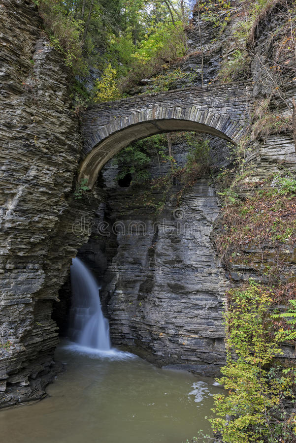 Waterfall Under Sentry Bridge in Watkins Glen State Park stock photos