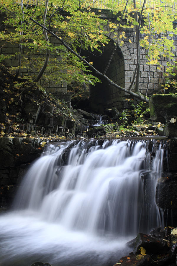 Waterfall Under Stone Bridge On The Satina River Stock Images