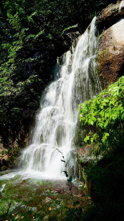 Waterfall. The water is being built. The flow of water on top of the rocks royalty free stock photography