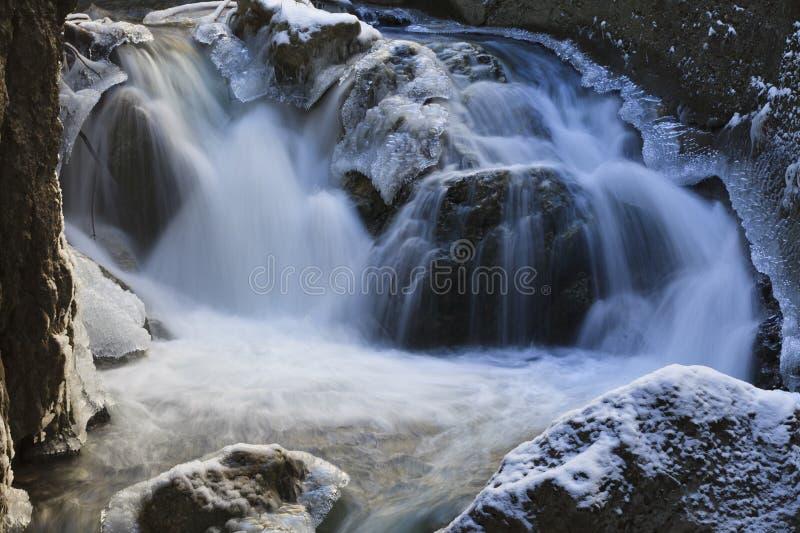 Waterfall in winter. Found on the Bistrita River, Romania stock image