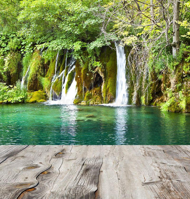 Waterfall and wood pier. Waterfall in deep forest of croatia and wood pier royalty free stock photography