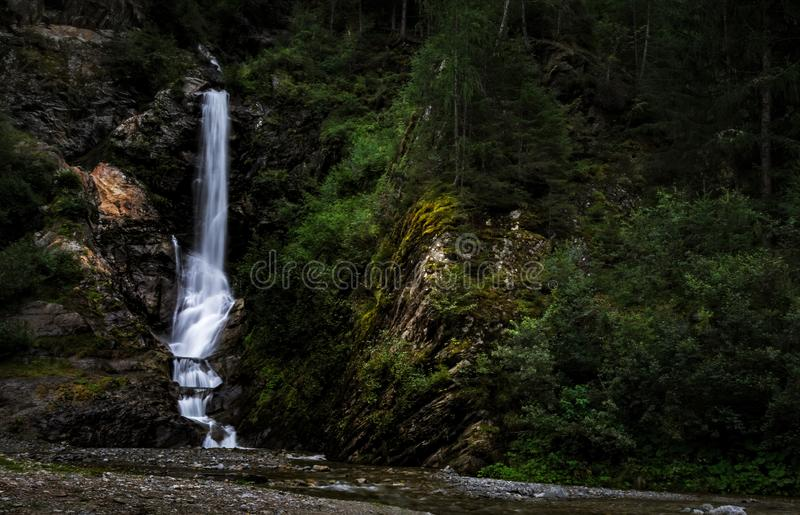 Waterfall in the wood. Near the town of Feichten, in the Kaunertal valley Austrian alps royalty free stock photography
