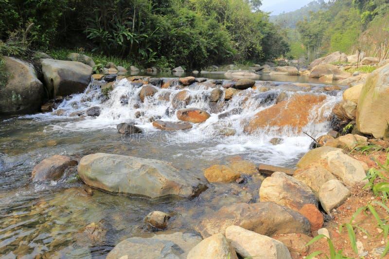 Waterfall of yuanyang xi ( mandarin duck ) creek stock photo