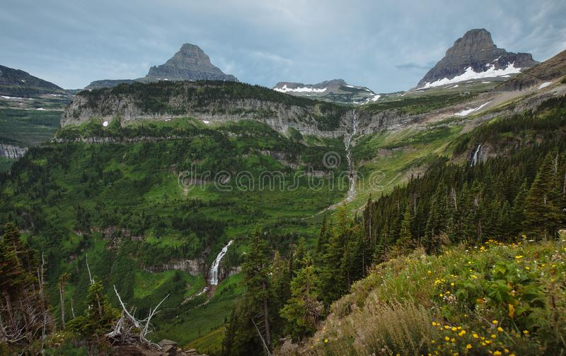Waterfalls Along Going-To-The-Sun Road with Reynolds Mountain and Clements Mountain in the background Glacier National Park.  stock image