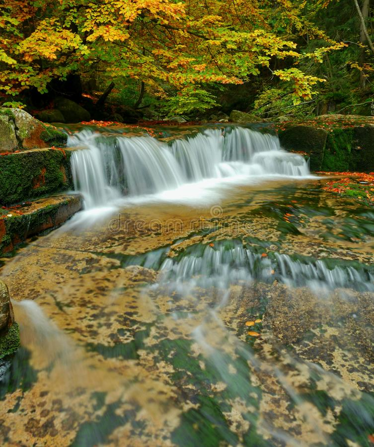 Waterfalls cascade in autumn forest. Beautiful colors of nature stock photography