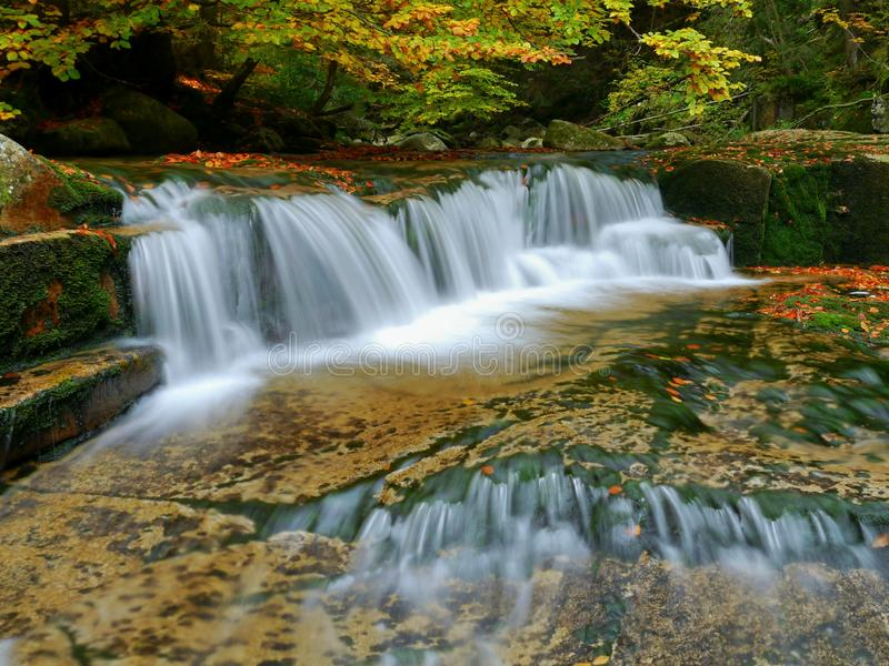 Waterfalls cascade in autumn forest. Beautiful colors of nature royalty free stock photography