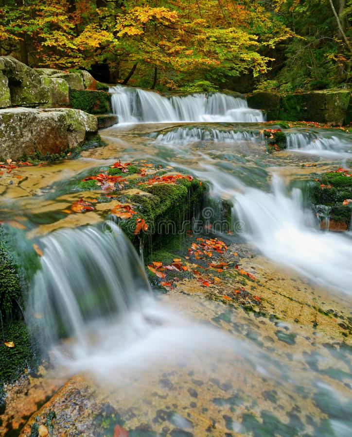 Waterfalls cascade in autumn forest. Beautiful colors of nature royalty free stock photos