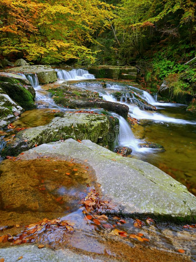 Waterfalls cascade in autumn forest. Beautiful colors of nature stock photo