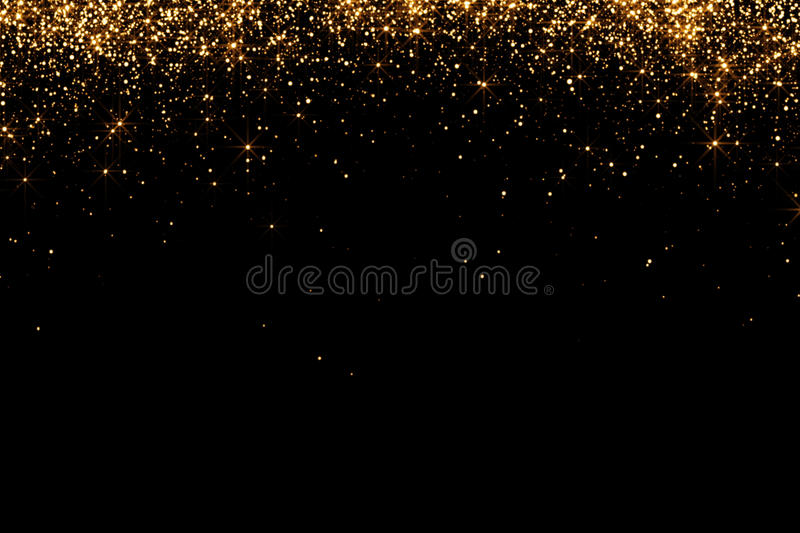 Waterfalls of golden glitter sparkle bubbles champagne particles stars on black background, happy new year holiday. Concept stock photo