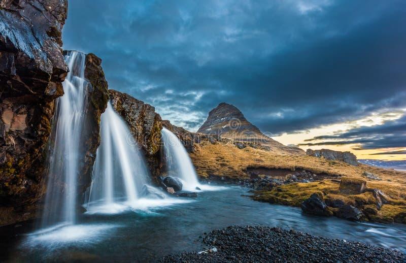 Waterfalls and kirkjufell, sunrise, Iceland. Waterfalls and kirkjufell during sunrise, Iceland royalty free stock photos