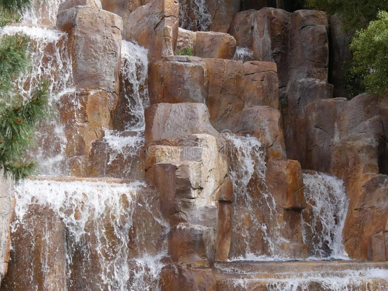 Waterfalls in a landscaped garden royalty free stock photos