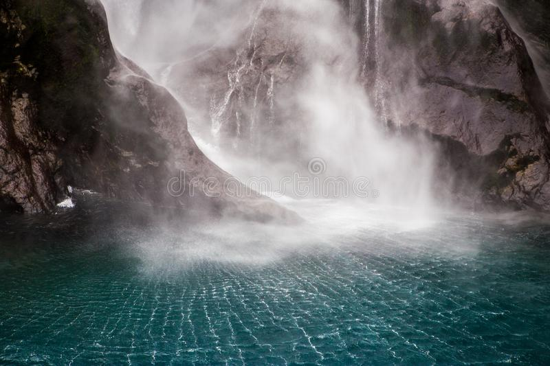 Milford Sound Waterfalls into Water stock photography
