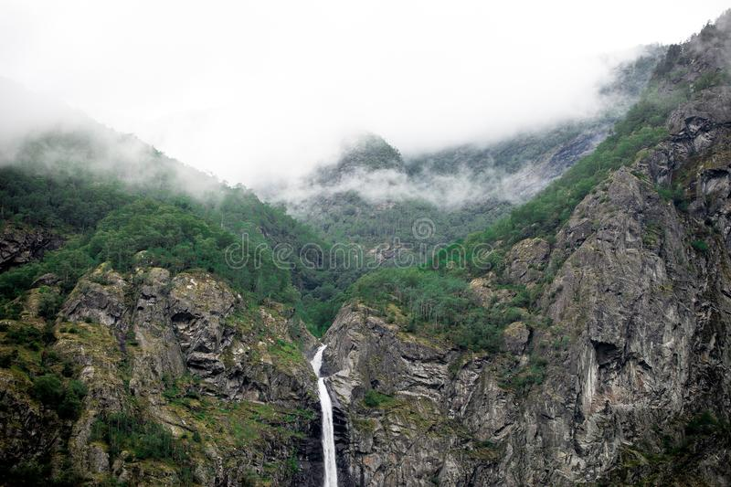 Waterfalls Between Mountain Rocks In Foggy Place Free Public Domain Cc0 Image