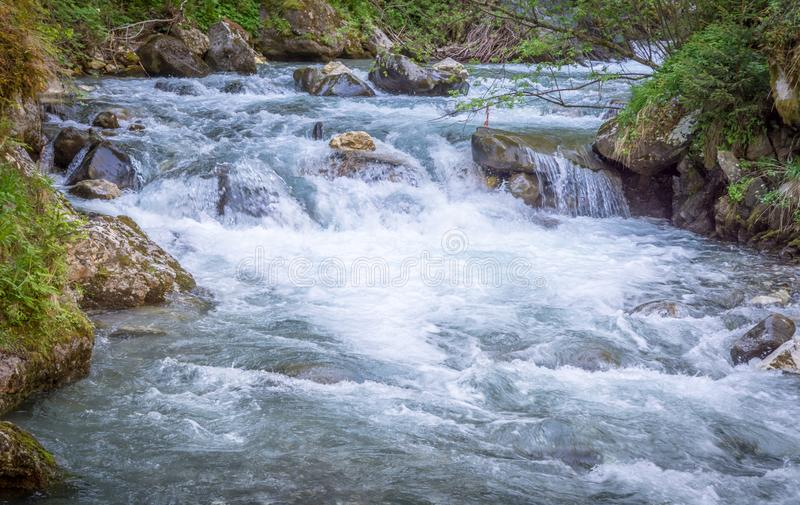 Waterfalls Stanghe Gilfenklamm localed near Racines, Bolzano in South Tyrol, Italy. Wooden bridges and runways lead through the stock images