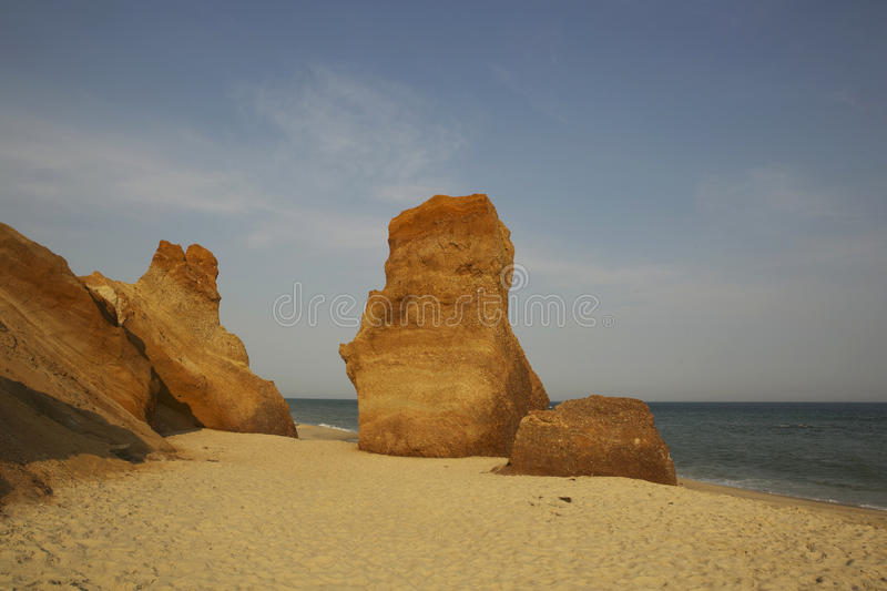 Waterflow and wind erosion on shoreline against blue sky royalty free stock photography