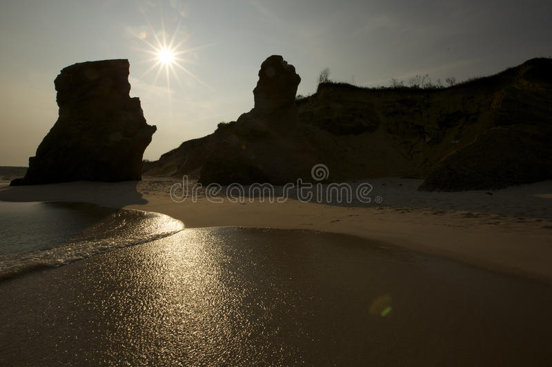 Waterflow and wind erosion on shoreline facing west stock photo