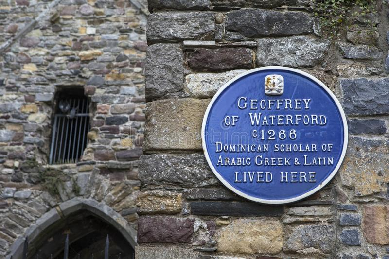Geoffrey of Waterford Plaque in Waterford. Waterford, Republic of Ireland - August 14th 2018: A blue plaque in the historic city of Waterford, marking the stock photo