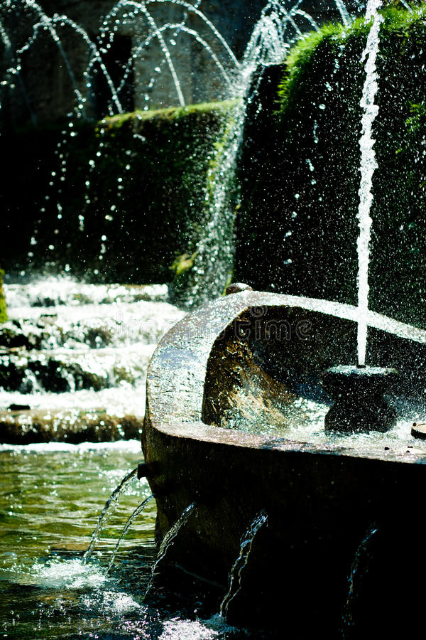 Waterfountain in a park. Water fountains in a park. The water is splashing royalty free stock image