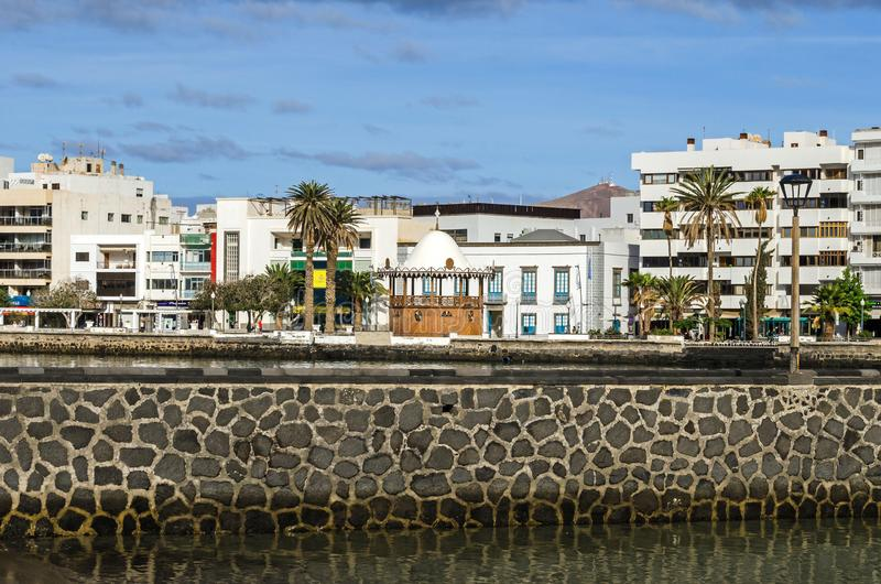 Waterfront Avenida la Marina and a carved pavilion of the tourist information center in Arrecife, Spain. Arrecife, Spain - November 5, 2018: View of the stock photography