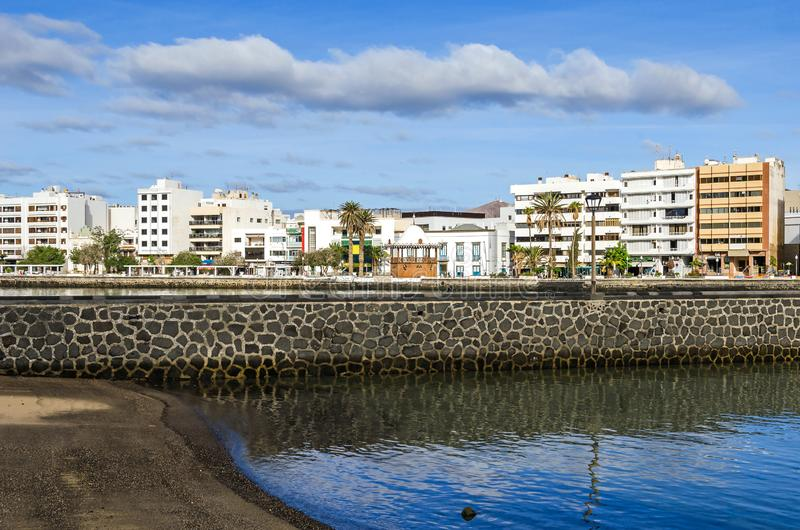 Waterfront Avenida la Marina and a carved pavilion of the tourist information center in Arrecife, Spain. Arrecife, Spain - November 5, 2018: View of the stock images