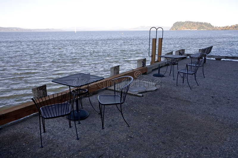 Download Waterfront cafe stock photo. Image of tables, patio, water - 1414478