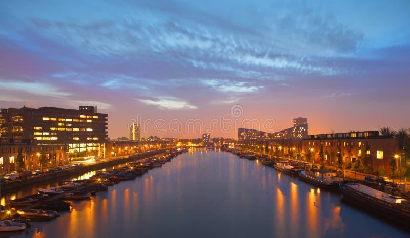 Waterfront canal near the Python bridge, Amsterdam royalty free stock photo