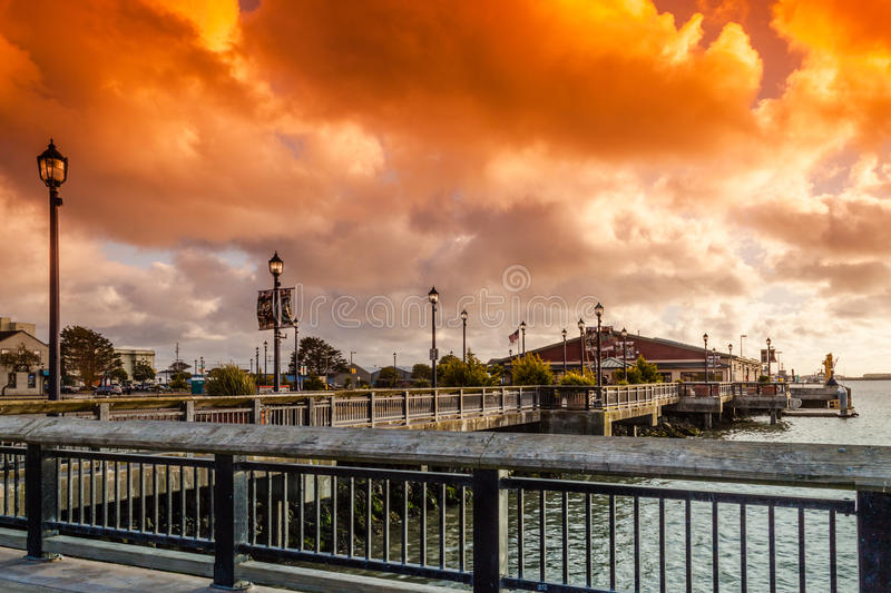 Waterfront of Eureka. View of the waterfront of downtown Eureka with big cloud formation at sunset stock photos