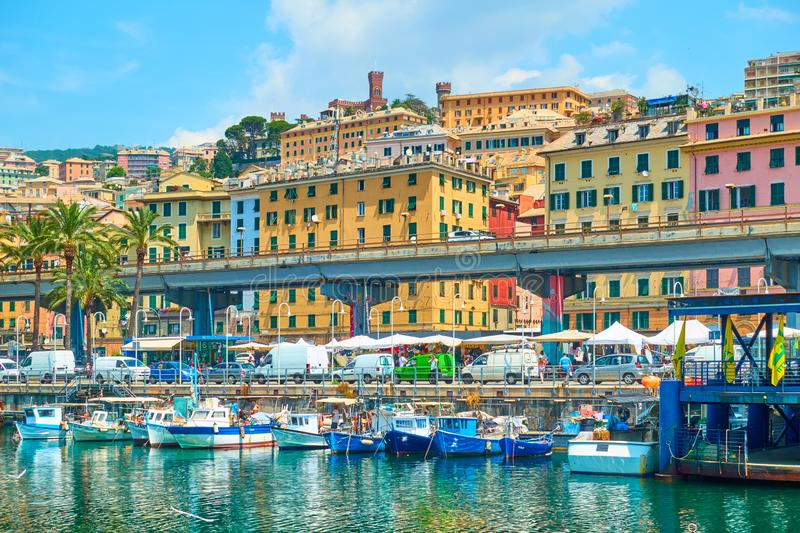 Waterfront and fishing boats in the Old Port in Genoa stock photo