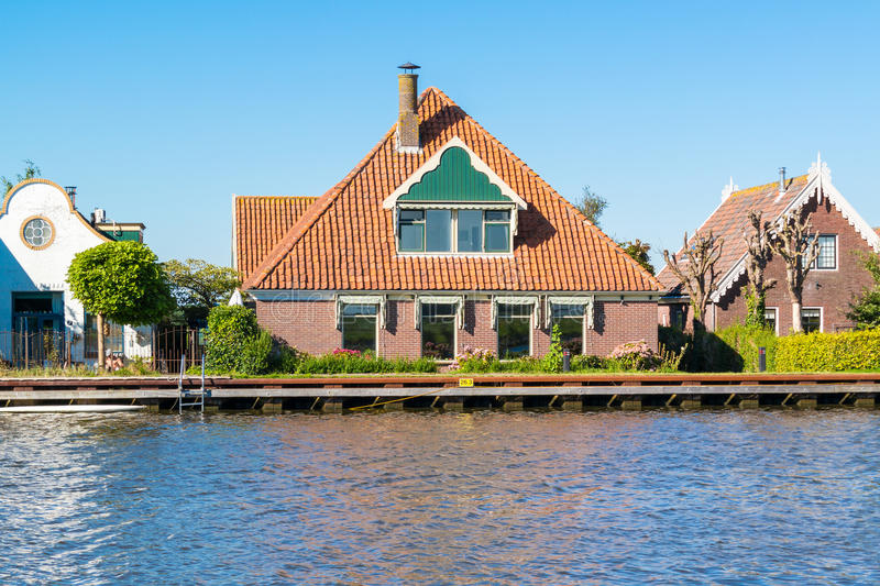Waterfront houses in North Holland, Netherlands. Waterfront houses alongside Noordhollandsch Kanaal in Oost-Graftdijk, Alkmaar, North-Holland, Netherlands stock photography